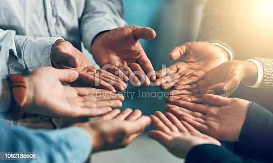 Cropped shot of a group of businesspeople with their hands opened