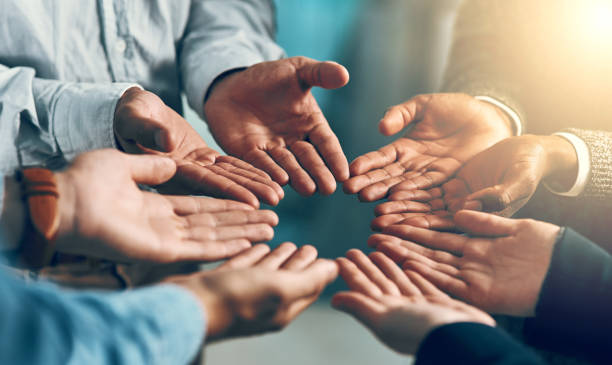 Open to anything Cropped shot of a group of businesspeople with their hands opened bailout stock pictures, royalty-free photos & images