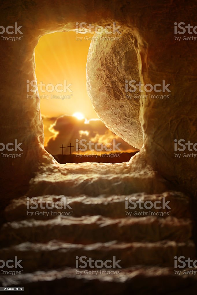 Open tomb of Jesus with sun appearing through entrance - Shallow...