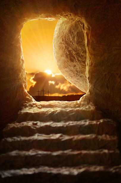 Open Tomb of Jesus Open tomb of Jesus with sun appearing through entrance - Shallow depth of field on stone tomb stock pictures, royalty-free photos & images