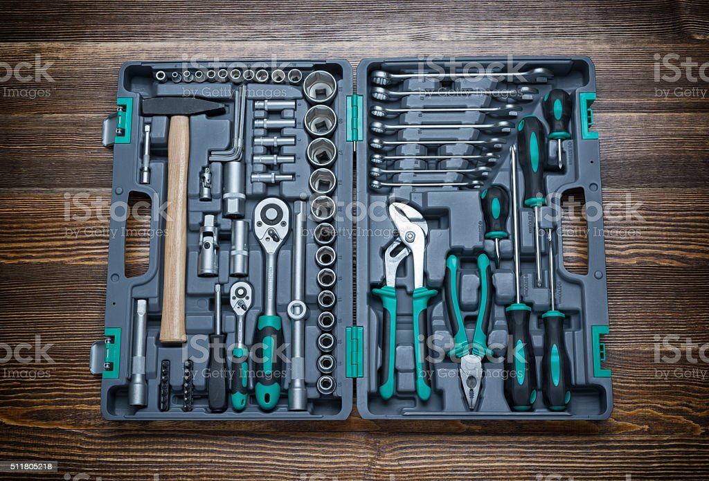 Open toolbox with different instruments on wooden workbench stock photo