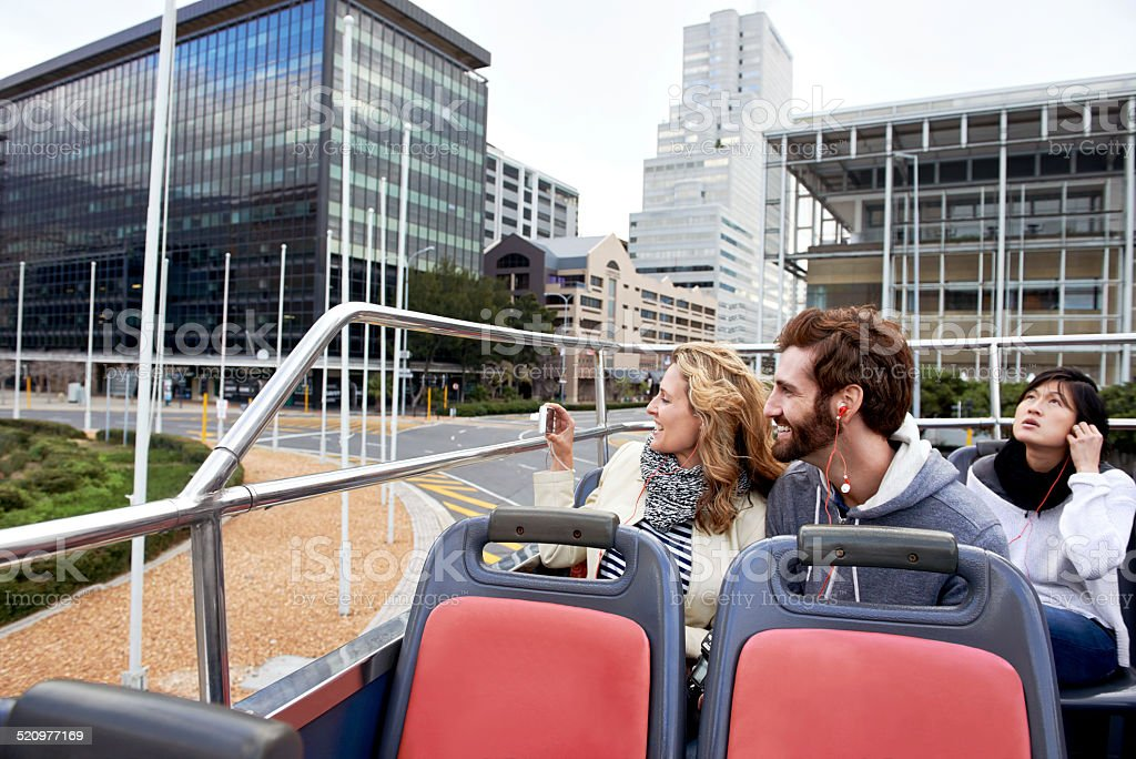 open top bus couple stock photo