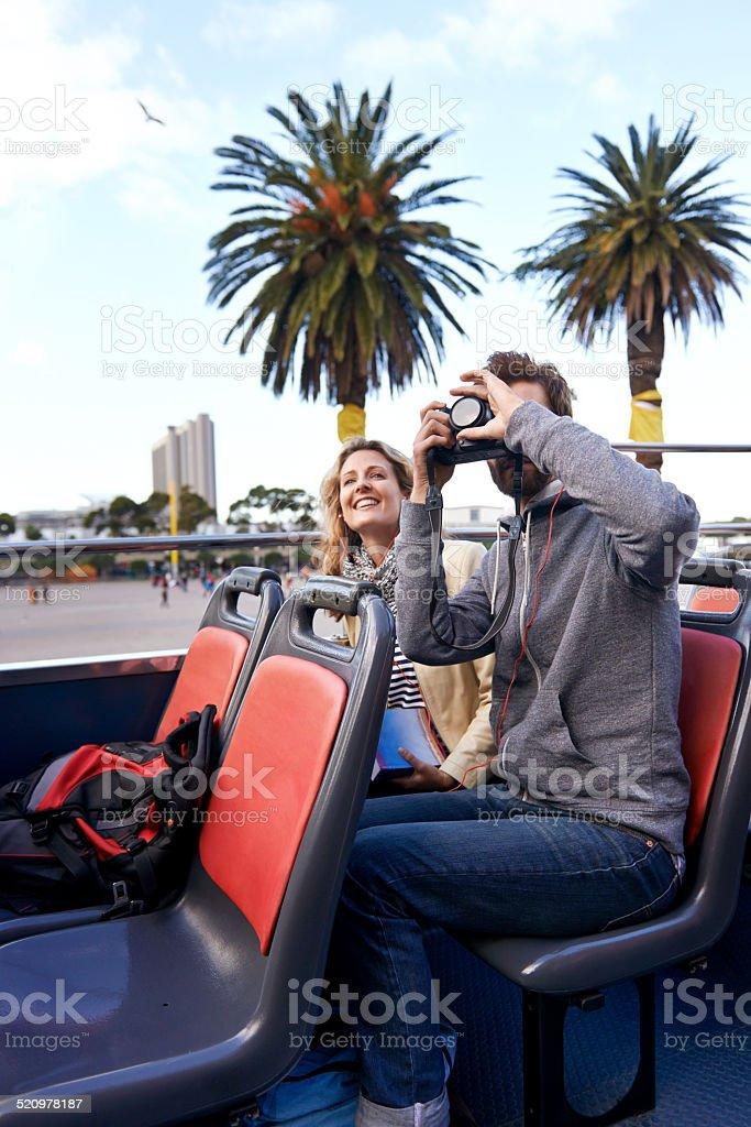 open top bus couple stock photo