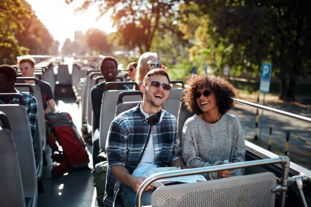 open top bus tour in the city - tour bus stock-fotos und bilder
