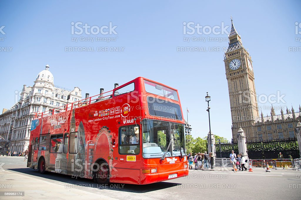 Open top site seeing City Tour bus passes Big Ben stock photo