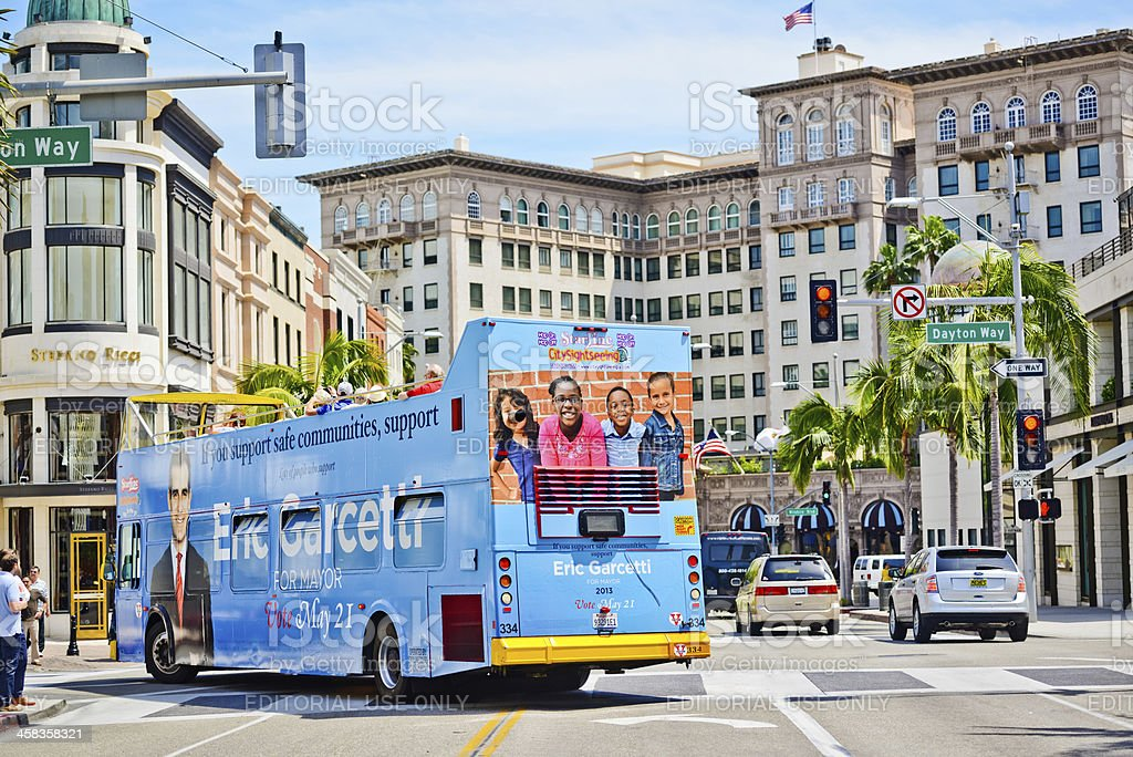 Open Top Tour Bus with Tourists on Rodeo Drive royalty-free stock photo