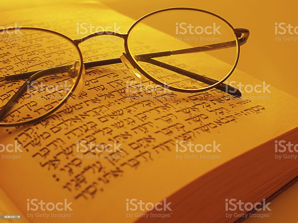 Open Torah and glasses stock photo