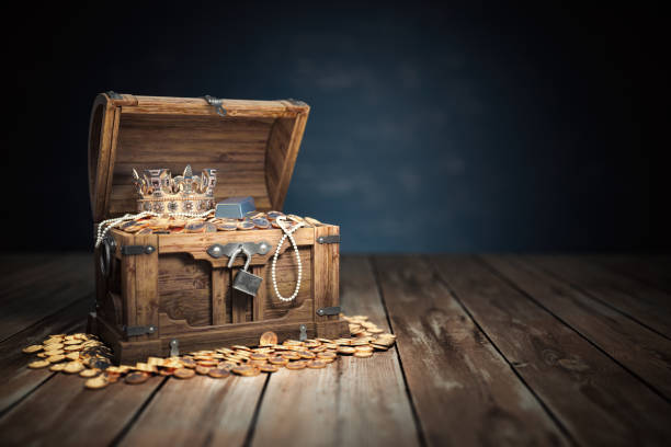 Open treasure chest filled with golden coins, gold  and jewelry. stock photo