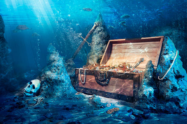 Open treasure chest underwater wooden treasure chest submerged underwater with light rays sunken stock pictures, royalty-free photos & images