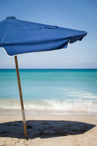 Open Umbrellas On The Sandy Shore Near The Ocean Beach In ...