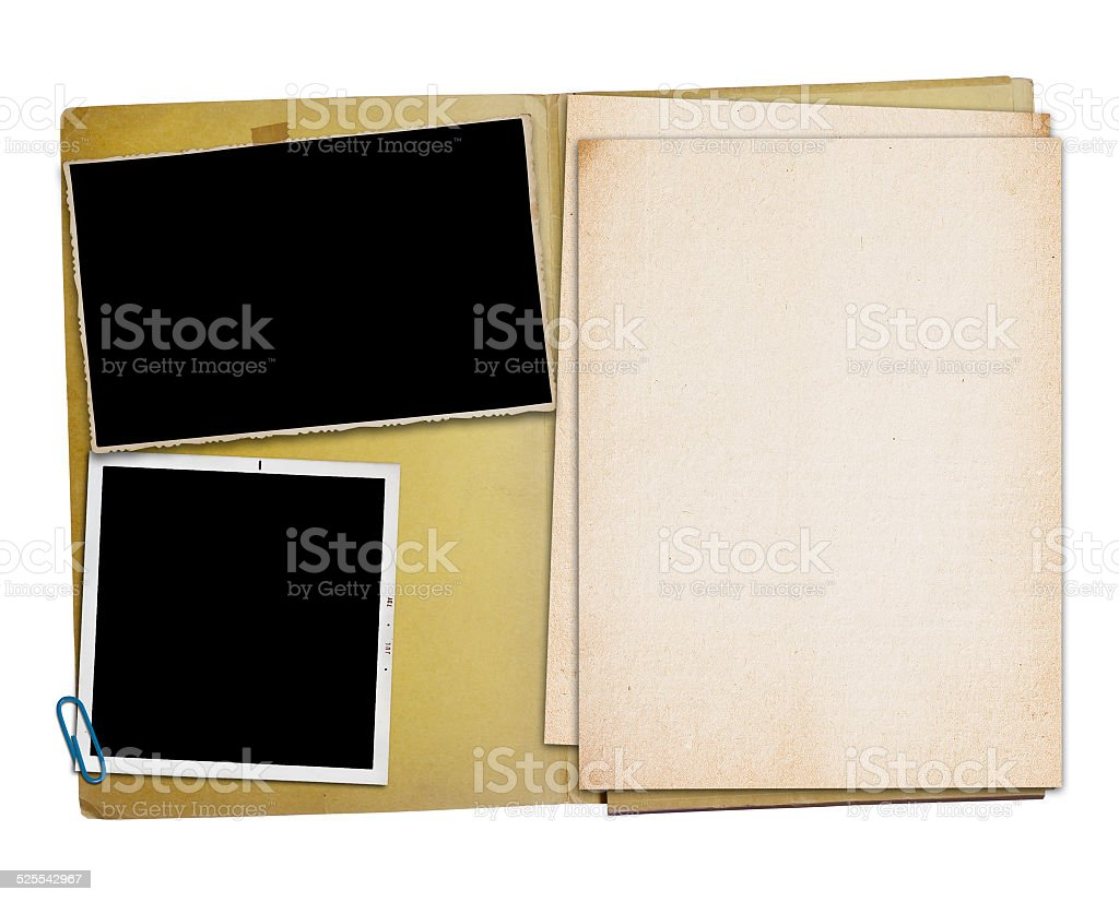 Open vintage folder with two old photographs, stock photo