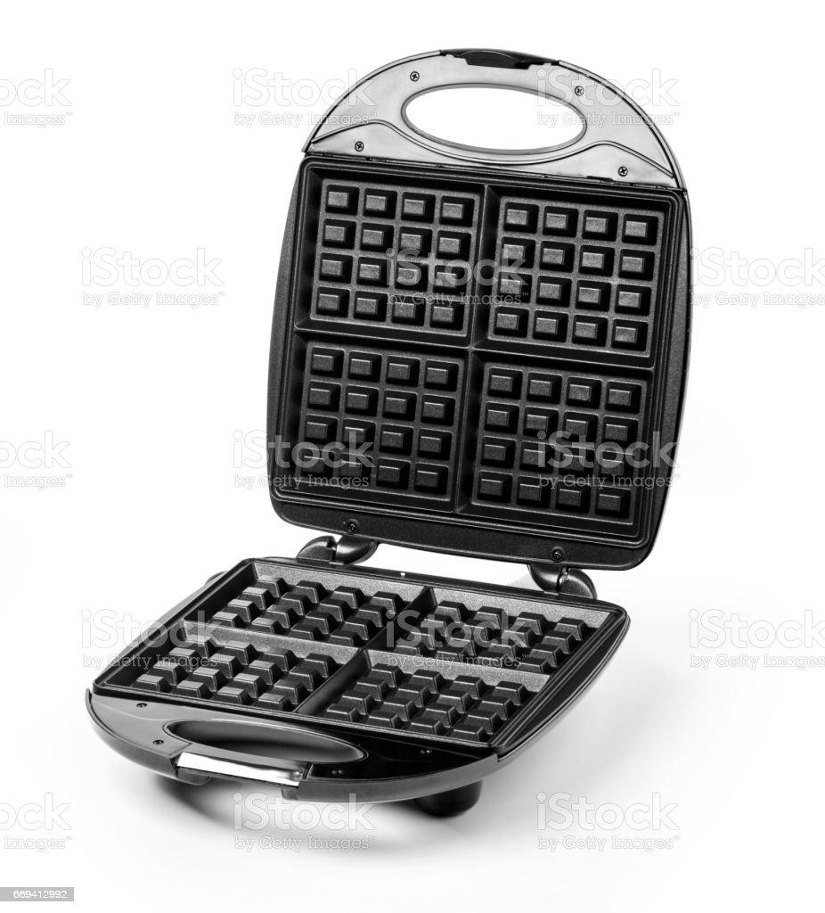 Open waffle iron stock photo