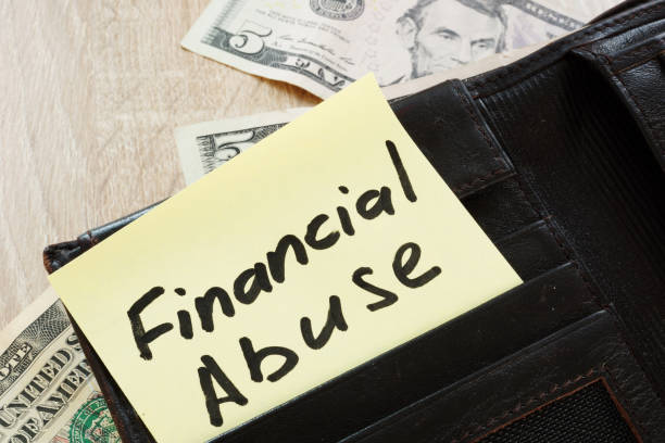 open wallet with words financial abuse. - financial abuse stock pictures, royalty-free photos & images