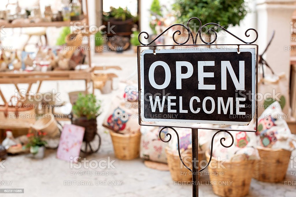 Open Welcome sign outside a market shop stock photo