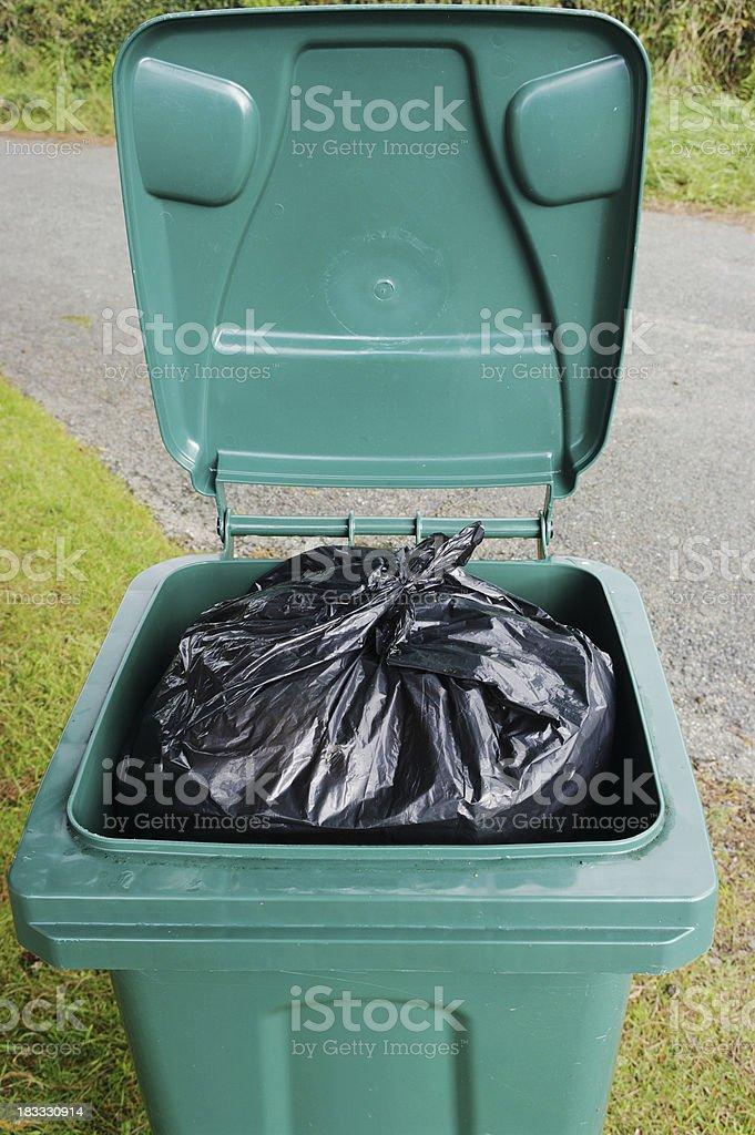 Open Wheelie Bin With Black Plastic Rubbish Bag royalty-free stock photo
