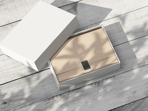 Open white Box Mockup with wrapping paper on wooden table outdoor. 3d rendering
