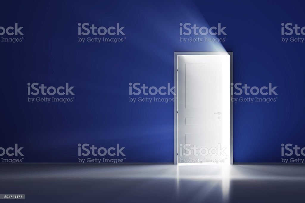 Open white door on blue wall stock photo