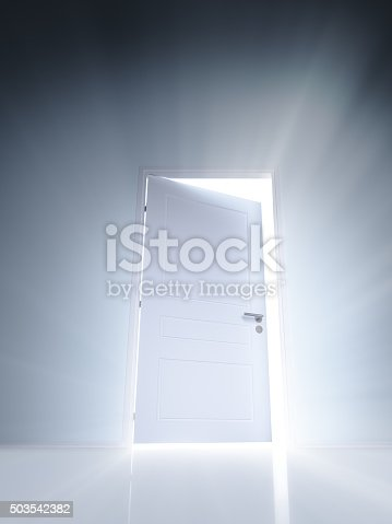 922736646 istock photo Open white door with rays of light on blue wall 503542382