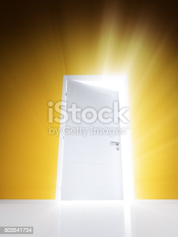 922736646 istock photo Open white door with rays of light on orange wall 503541734