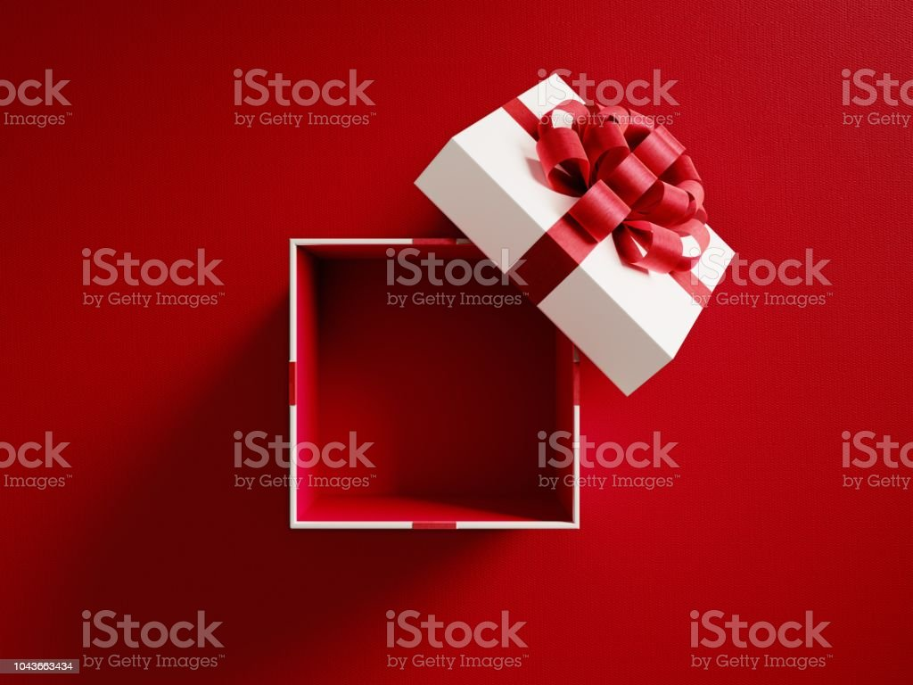 Open White Gift Box Tied With Red Ribbon stock photo