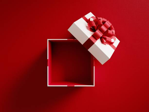 Open White Gift Box Tied With Red Ribbon Open white gift box tied with red ribbon on red background. Horizontal composition with copy space. Directly above. Great use for Christmas and Valentine's Day related gift concepts. gift box stock pictures, royalty-free photos & images
