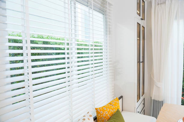 Open white horizontal window blinds stock photo