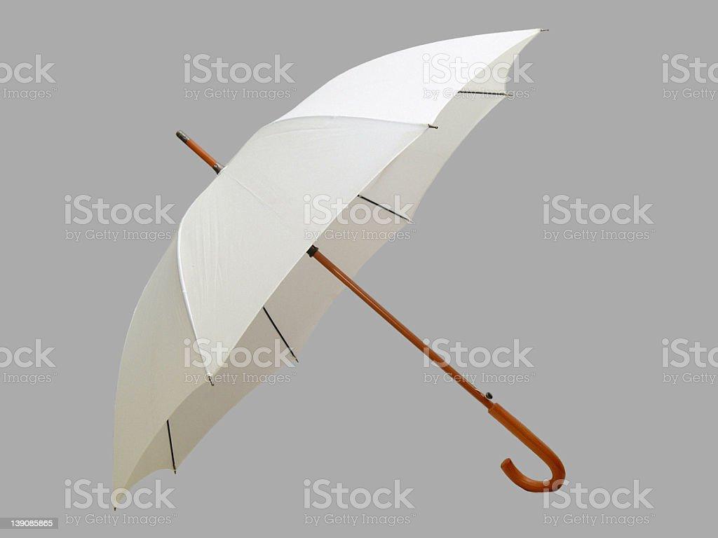 Open white umbrella against gray background royalty-free stock photo
