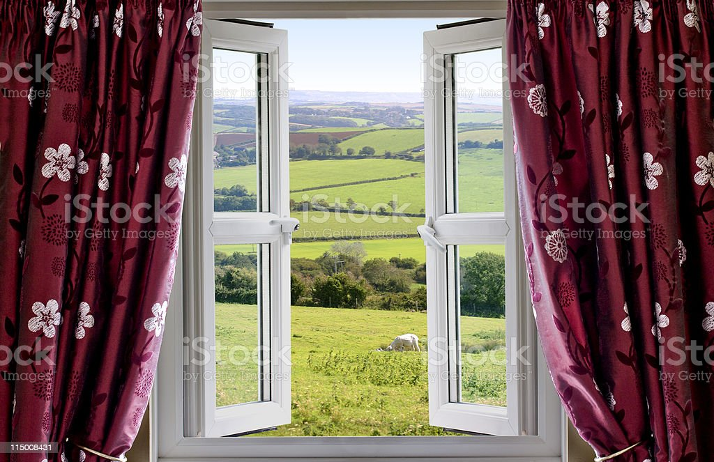 Open window and curtains with a rural view stock photo