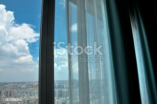 Open window、 curtain and sunrise
