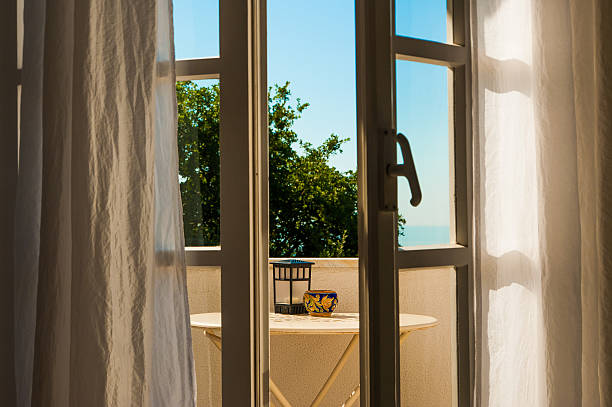 Open window with relaxing mediterranean viewin the morning stock photo
