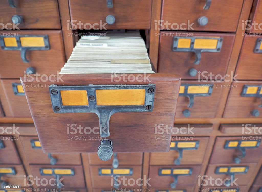 Open wooden boxes with index cards in library stock photo