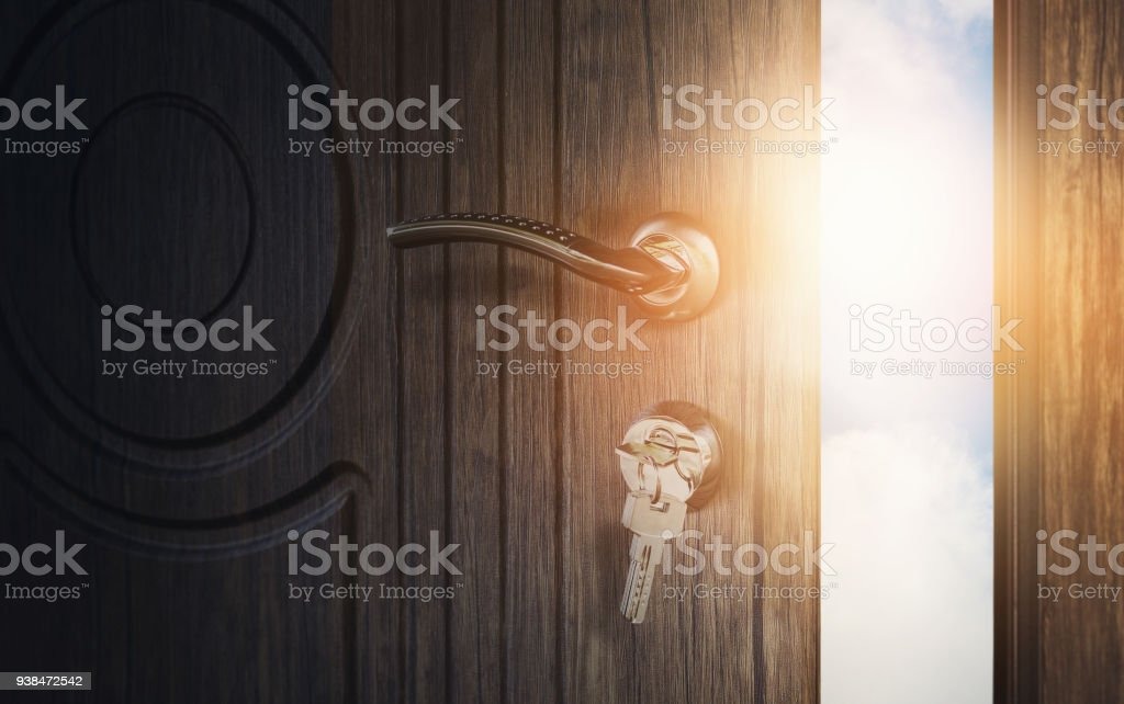 Open wooden doors with sky background stock photo