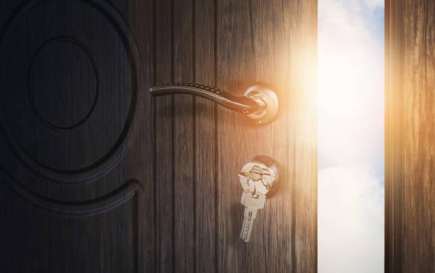 Open wooden doors with sky background stock photo