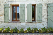 open wooden window shutters on a french house