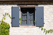 Open wooden window shutters on a french farm house