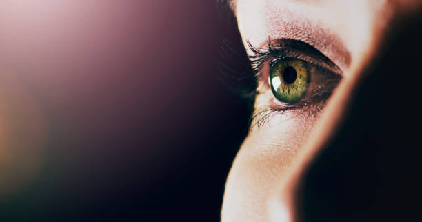 Open your eyes to what's in front of you Studio shot of a man opening his eyes against a dark background zoom effect stock pictures, royalty-free photos & images