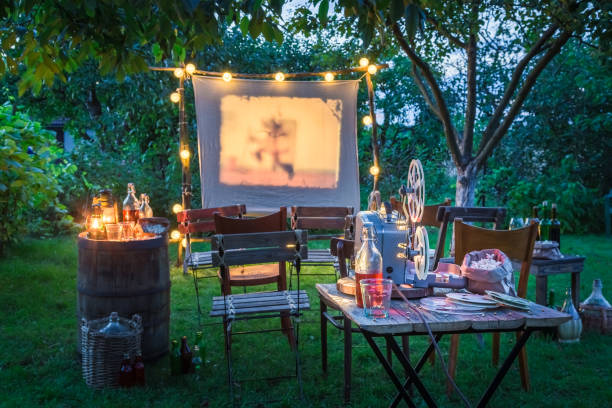 Open-air cinema with drinks and popcorn in the garden stock photo