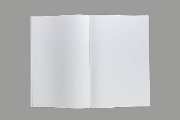 opened a4  book or catalog or magazine - smeren stockfoto's en -beelden