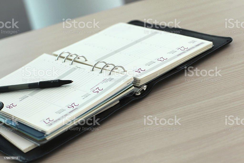 Opened agenda on wood table royalty-free stock photo