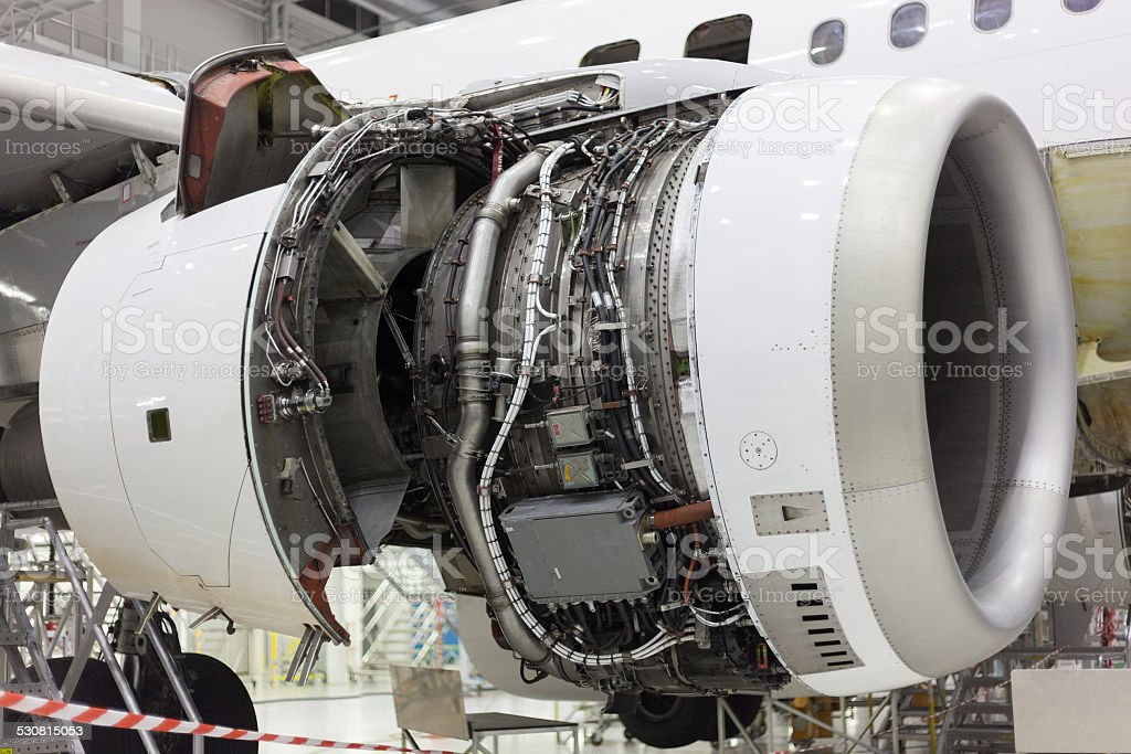 opened aircraft engine in the hangar stock photo