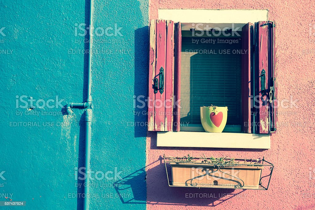 opened balcony from a pink painted house stock photo