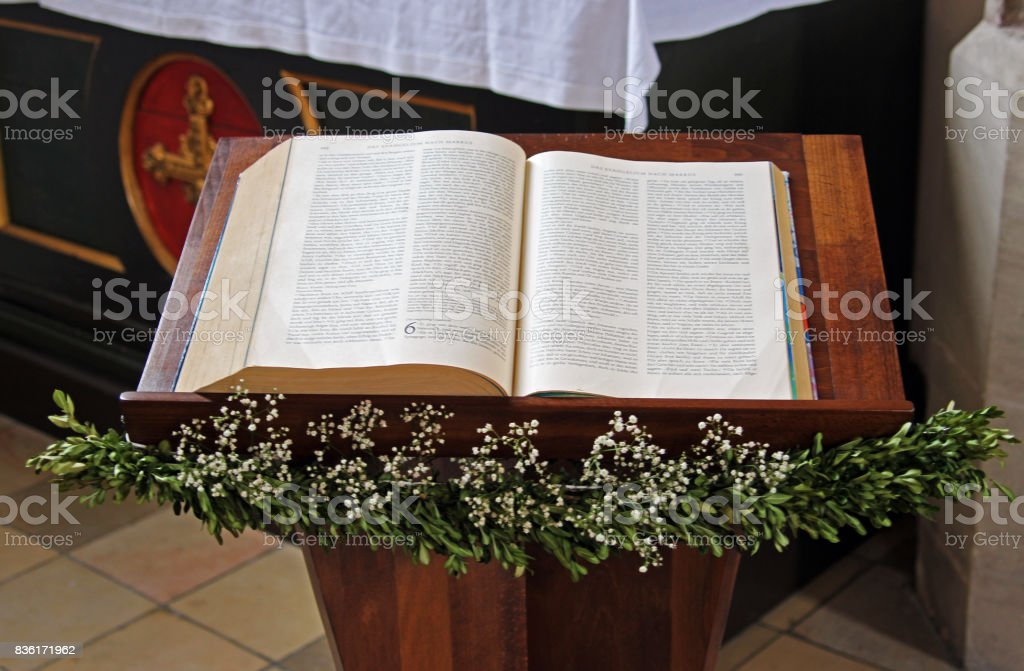 opened bible in a church stock photo