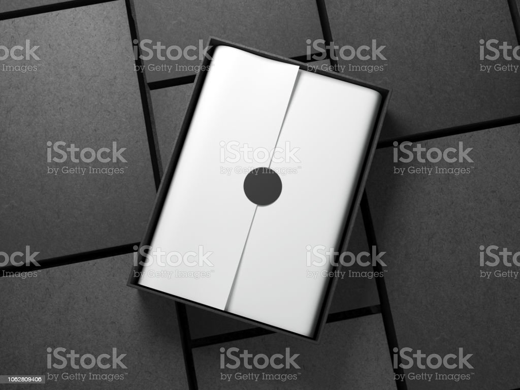 Opened black Box with white wrapping paper and circle sticker, Horizontal stock photo