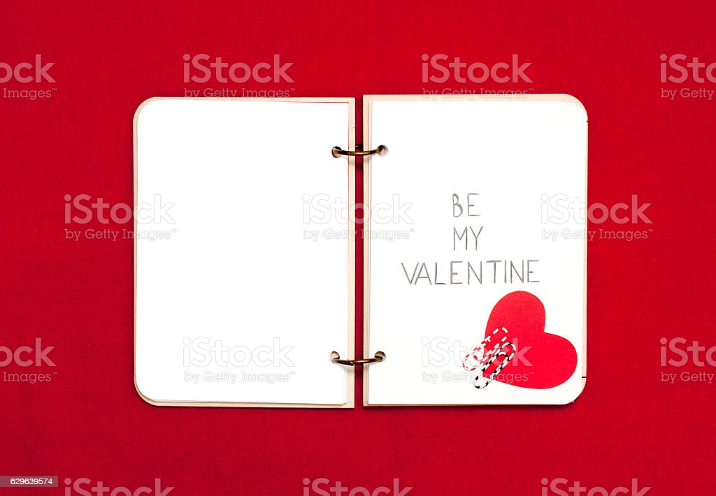 Opened blank notepad on red background. Valentine's hart stock photo