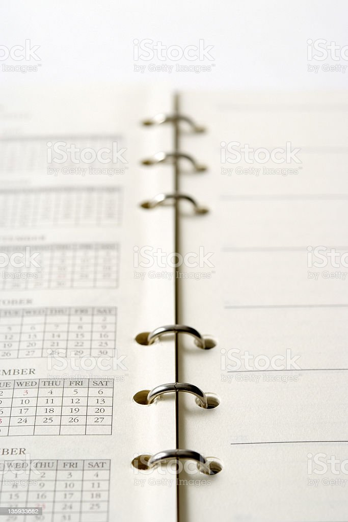 Opened blank personal organizer with shallow depth of field royalty-free stock photo