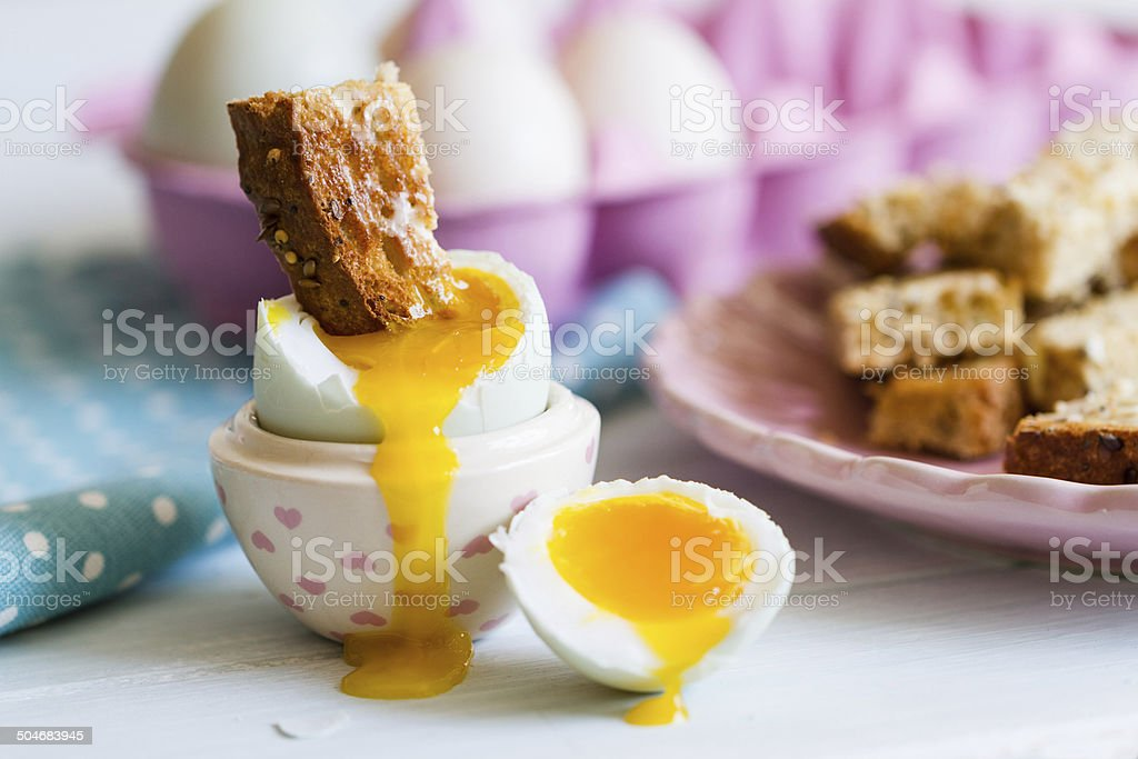 Opened boiled blue duck egg with soft yolk with toast stock photo