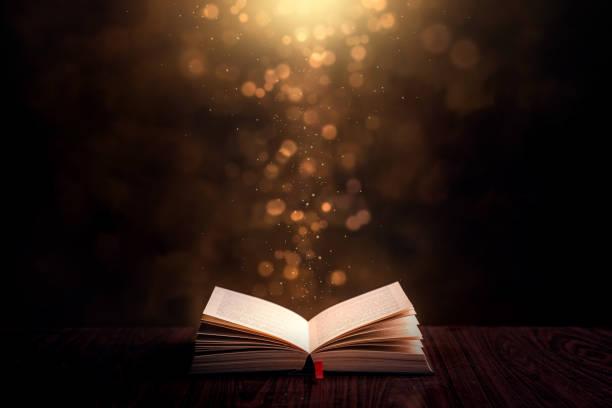 opened book and bible - open book zdjęcia i obrazy z banku zdjęć