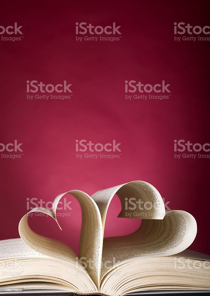 Opened book and heart shape royalty-free stock photo