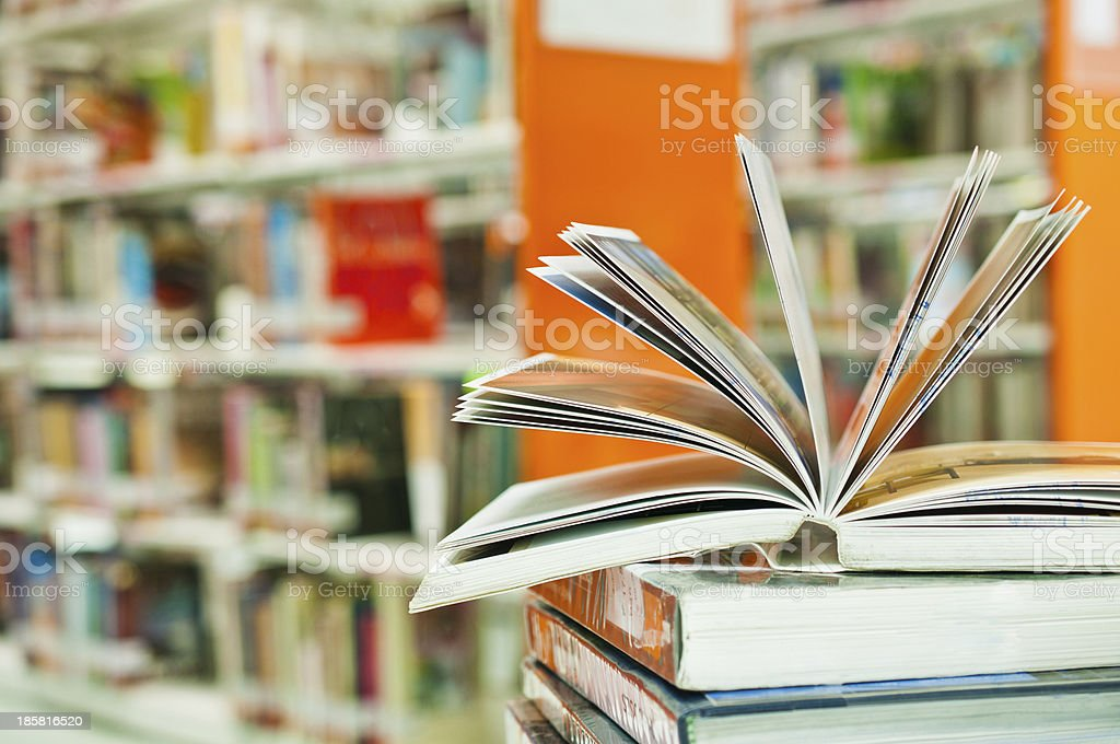 opened book in library royalty-free stock photo