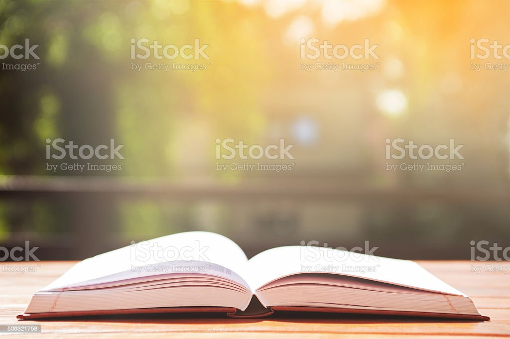 opened book on table stock photo
